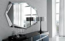 Decorar con espejos ovalados en las paredes